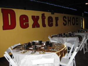 Dexter Shoe sign with decorated table settings at event