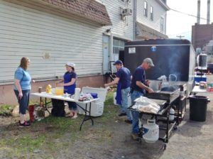 employees cooking breakfast outside