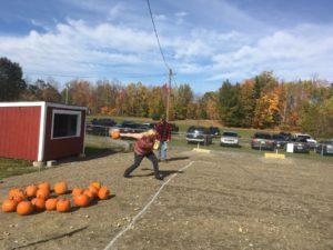 woman throwing pumpkin