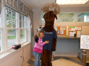 young child posing with Monty Moose