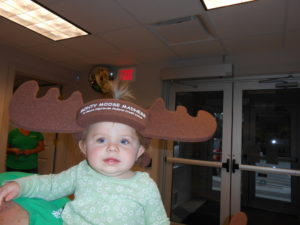 young child wearing foam antlers