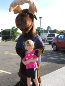 young girl posing with Monty Moose