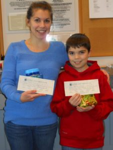 mother and son showing off their winning prizes