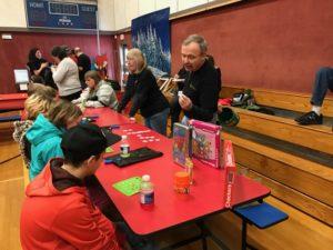 children playing Bingo at event