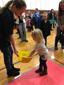 young girl choosing a prize at event