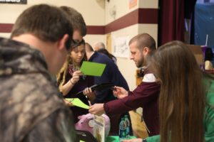 students at one of the booths of the financial fitness fair
