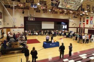 gymnasium full of students attending a financial fitness fair