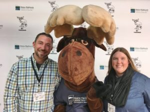 man and woman posing with Monty Moose at Moosetech