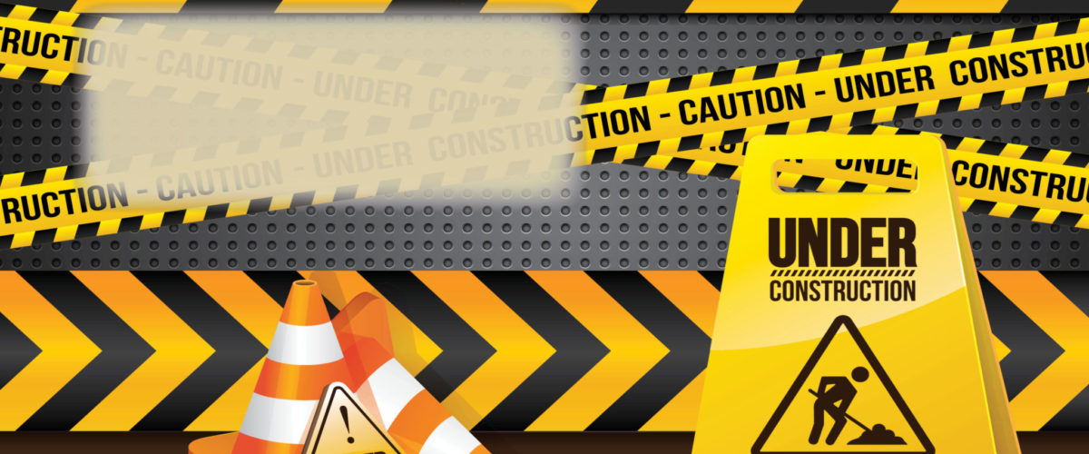 Under Construction sign with caution tape