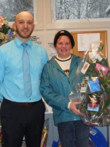 winner holding tree of gift cards