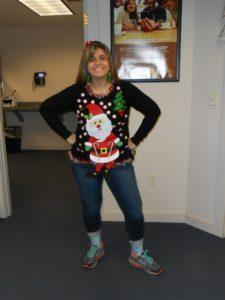 employee in ugly Christmas sweater