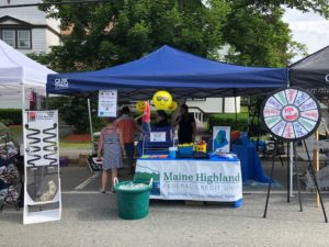 Credit Union tent set up at the festival with games and decorations