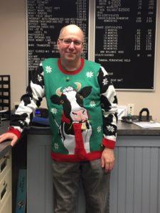 employee in ugly Christmas sweater