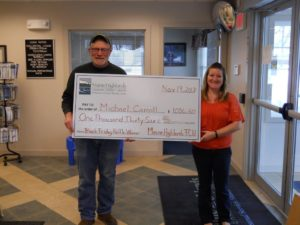 First place winner holding large check with Brownville employee