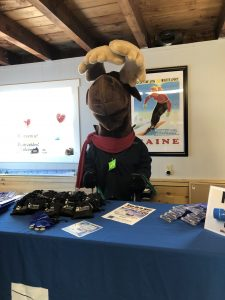 Monty Moose at table with giveaways