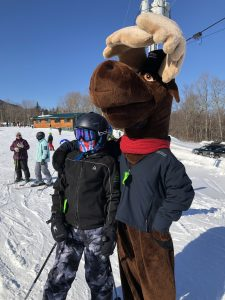 Monty Moose with skiier