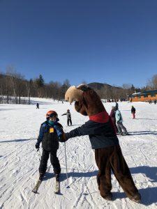 Monty Moose watching skiiers