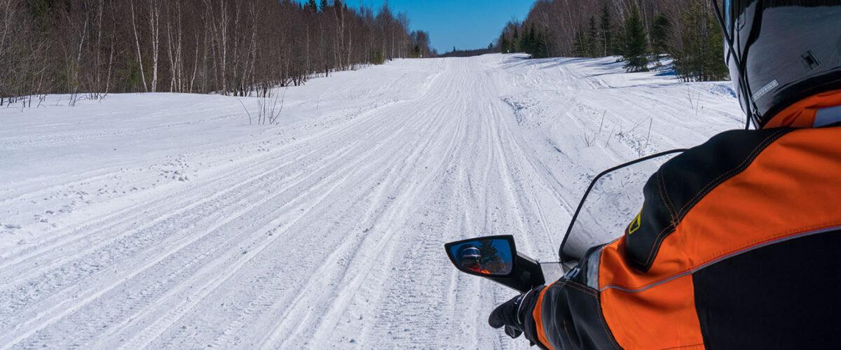 snowmobiler riding on trail